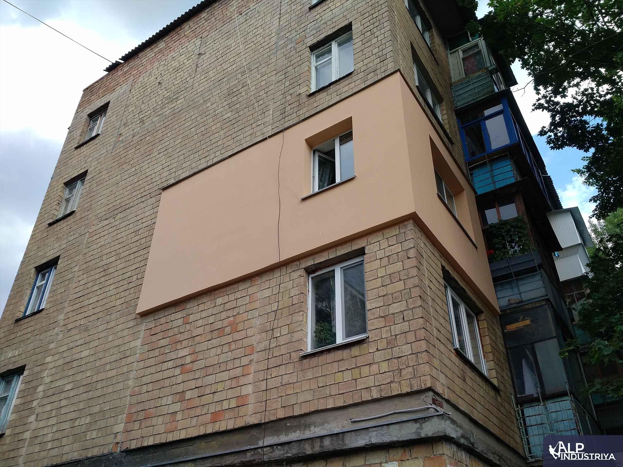Выполненная теплоизоляция стен снаружи здания-1