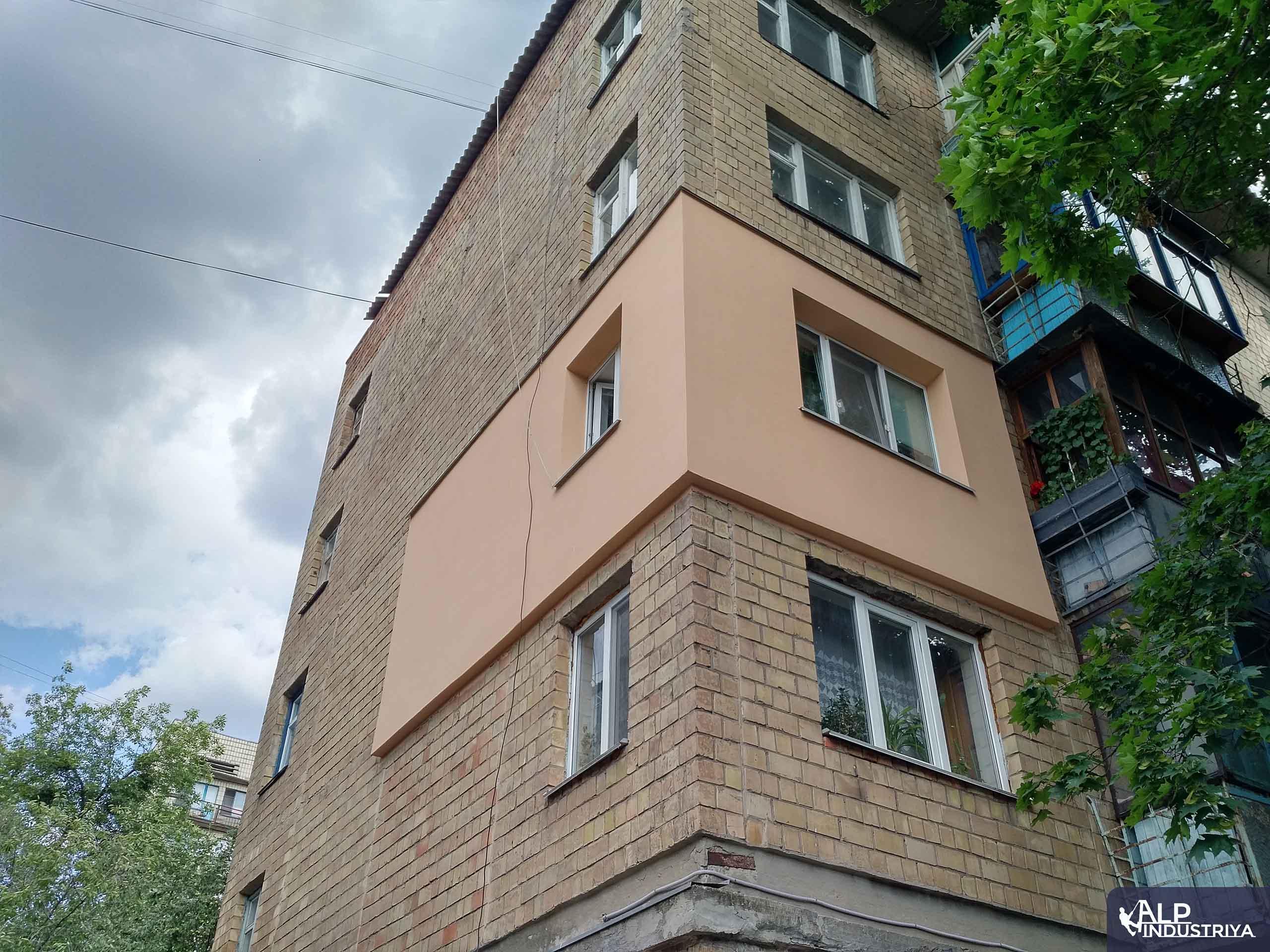 Выполненная теплоизоляция стен снаружи здания-2